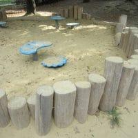Sandmuldeneinfassung aus Holz